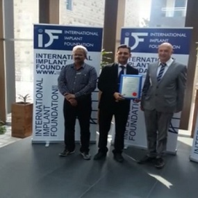 Award receive from Prof. Ihde in Germany